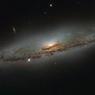 Объятия Созвездия Девы лишают галактики сил (ФОТО)