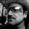 Боно рассказал, что скрывает за темными очками 20 лет подряд