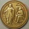 Медали Ватикана отчеканили с опечаткой в имени Иисуса