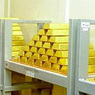 Мировые цены на золото снизилось к минимум за полтора месяца