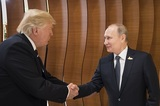 Путин все же встретился и пожал руку Трампу на церемонии фотографирования