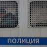 Сдавшегося полиции захватчика банка в Москве повезли на допрос