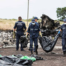 Останки девяти погибших в крушении «Боинга» доставлены в Малайзию