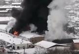 По делу о пожаре на складе в Красноярске задержали двух человек