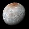 Плутон: безмятежное синее небо и зловещий красный лед (ФОТО)