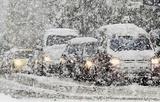 Мощный снежный циклон заблокировал дороги Омска