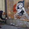 Академия художеств Британии узнала, кто скрывается под маской Бэнкси?