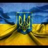 Участники беспорядков в Киеве прикрепили к козырьку посольства РФ флаг Украины